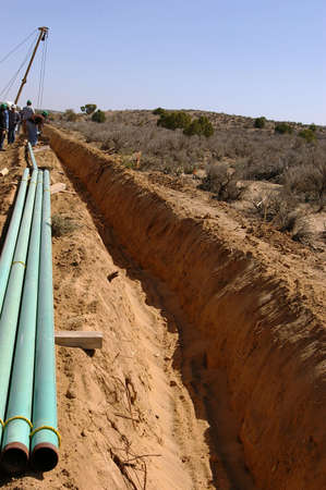 Open trench with staged pipe at a construction site. Imagens - 3056209