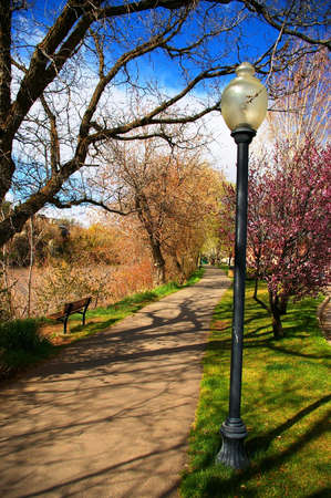 Paved walking and cycling path along the river. Imagens - 3085984