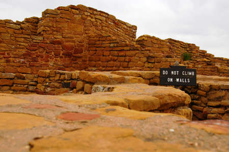 Sign on pueblo ruin that forbids climbing. Stock Photo