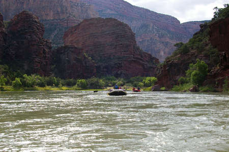 rafters: Group of river rafters floating on a wilderness river.