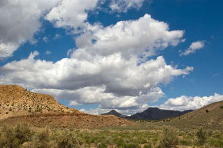 Bright clouds and dark hills on a spring day in the Great Basin. Stock Photo - 4809588
