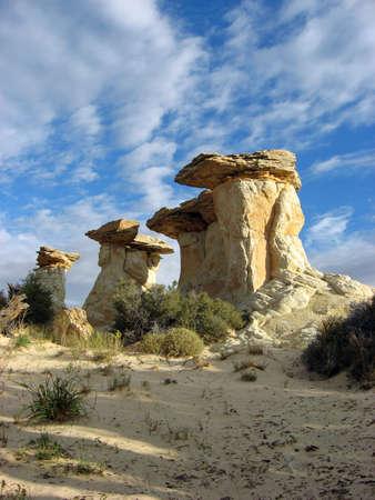 hoodoos: A small group of sandstone hoodoos in a remote desert area.