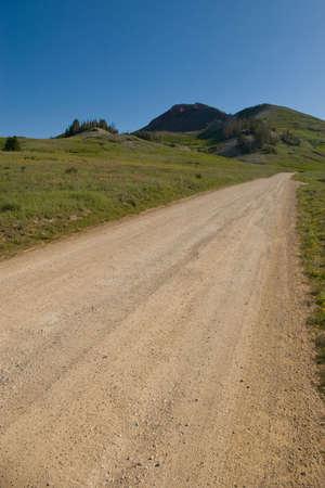 A gravel road leading to a mountain peak. Stock Photo - 5205874