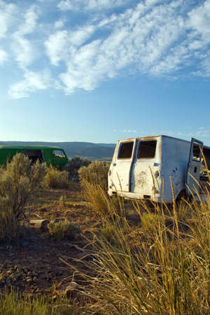 Two abandoned camper vans in a rural meadow. Stock Photo
