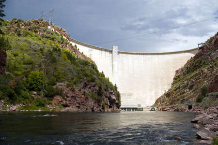 A large, electricity producing dam on a river.