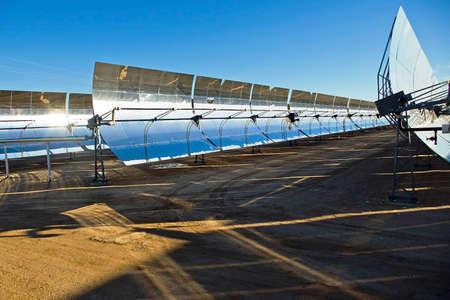 Row of solar panels in the bright desert sun.