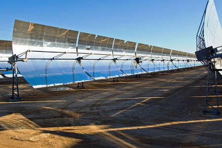 Row of solar panels in the bright desert sun.
