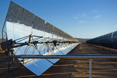 A row of mirrors at a solar energy station in the desert.