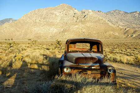 An old flatbed truck in a high desert valley.