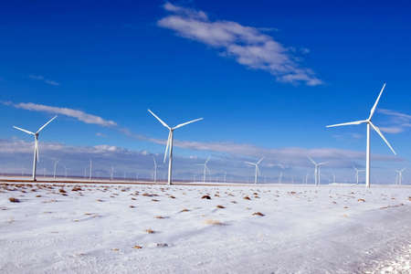 New wind turbines produce energy at a high desert wind farm.