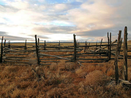 Faded wooden corral at an old ranch.
