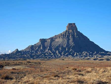 butte: A tall butte of Mancos Shale in a winter desert.