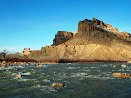 A desert river flows from a canyon in winter. Stock Photo - 9078452