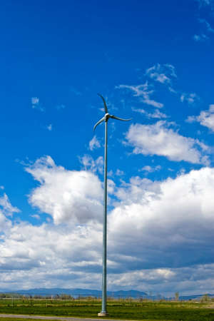 generates: A small wind turbine generates power for a local school.