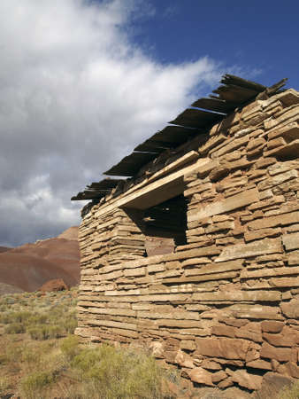 A crumbling cabin in a western ghost town.