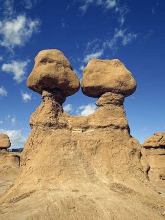 balanced rocks: A pair of sandstone balanced rocks in a desert area