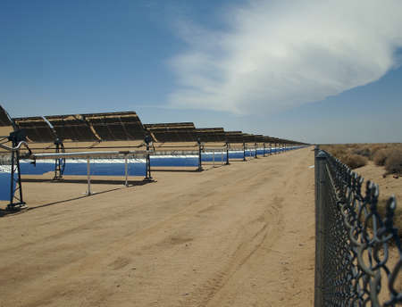 A row of solar mirrors in the Mojave Desert  Stock Photo