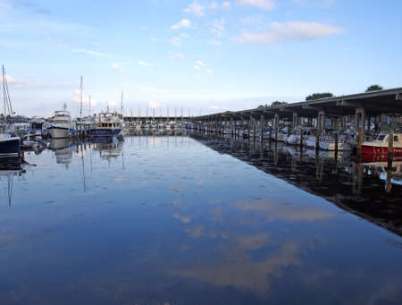 Boats at rest in a placid harbor. Stock Photo - 16979865