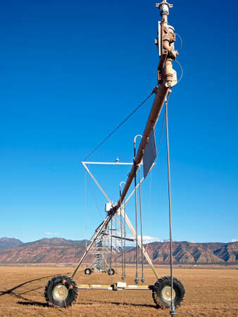 A center pivot irrigation system in an early spring field.