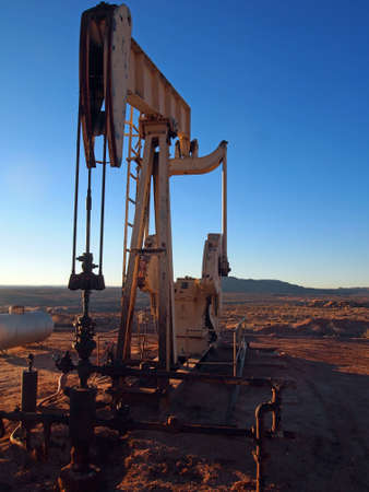Pumping hydrocarbons at a desert well on a winter afternoon.