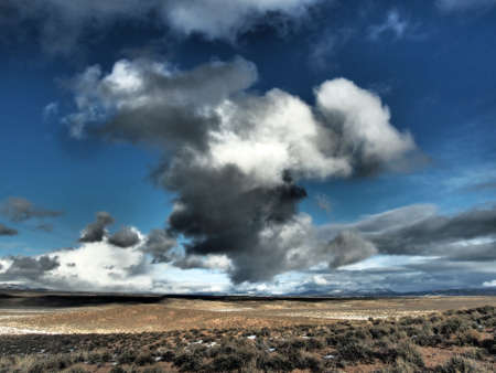 Towering clouds gathering over the ranch country during the winter.