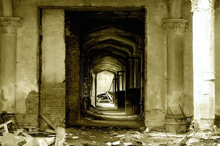forgotten: A pillared hallway with open doors in an old, forgotten castle ruin in Europe,