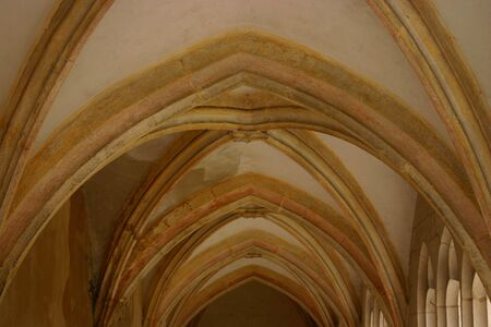 workship: Vaulted ceiling of an abbey hallway