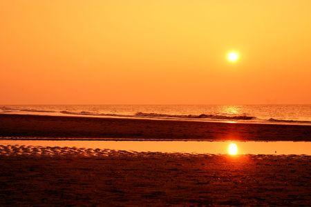 A beautiful orange sunset at sea photo