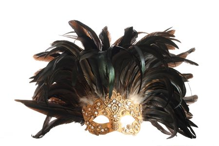 A golden feathered Venetian mask isolated on a white background.