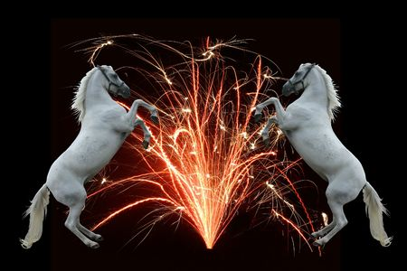 A fountain of fire with two rearing horses flanking it on a black background. photo