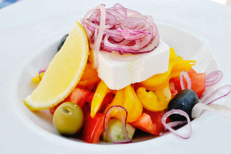 delicious fresh Greek salad on white plate