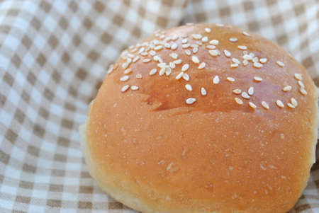 small bun with sesame seeds Imagens
