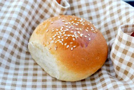 small bun with sesame seeds.