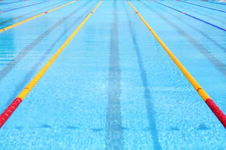 Empty swimming pool. Texture of classic blue water.