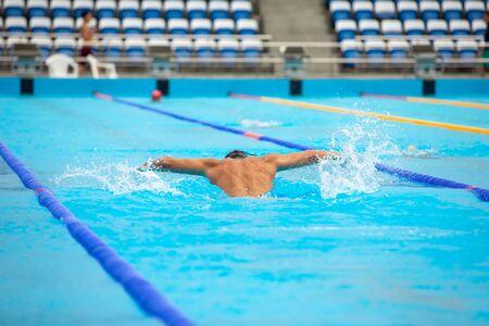 Triathlon fitness athlete training swimming in the swimming pool. Reklamní fotografie