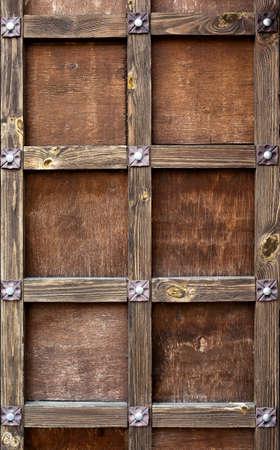 Vintage wooden brown front door.