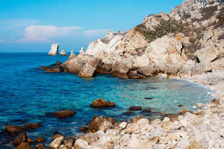 Beautiful west coast beach of Crimea with rocks.
