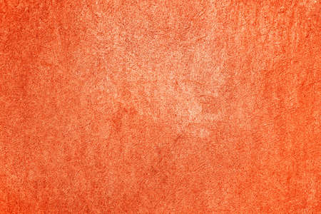 Texture of old burnt orange wall for background.