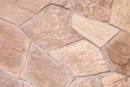 Texture of a stone wall. Beige texture background.