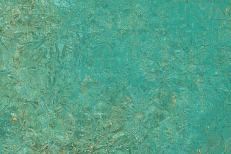 Green texture with gold cracks. Grunge surface.