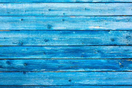 Weathered blue wooden background texture. Shabby blue painted wood.