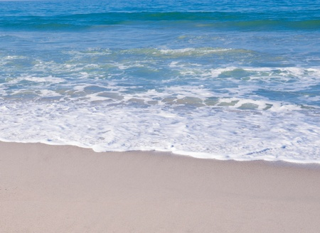 Soft wave on the sandy beach