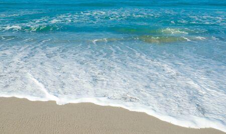 Wave on the sandy beach