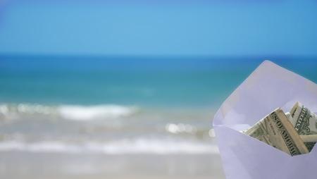 White Envelope with money on the ocean phone Stock Photo