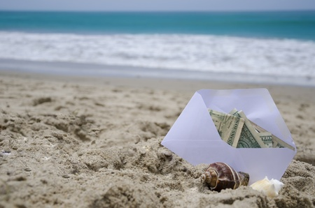 White Envelop with money for vacation on the ocean phone