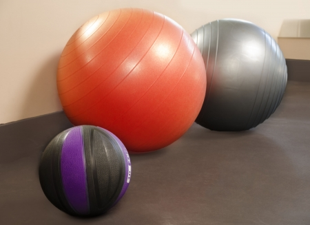 Two Fitballs and ball in the gym Stock Photo