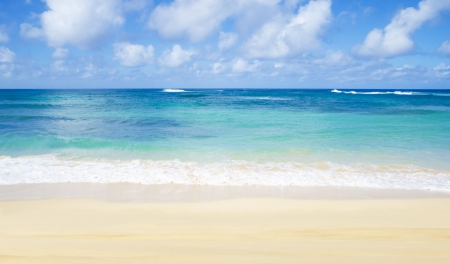 Gentle waves on the sandy Poipu beach in Hawaii, Kauai Stock Photo