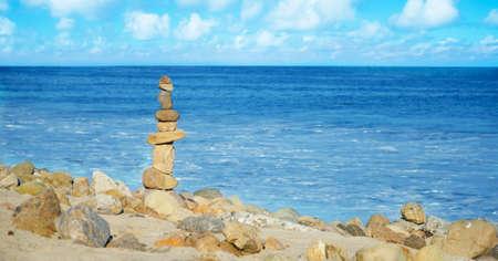 Stack of sea rocks balancing by Pacific ocean