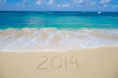 Number 2014 on the sandy beach - concept holiday Stock Photo