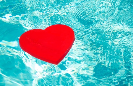 Heart shape in swimming pool - holiday concept photo